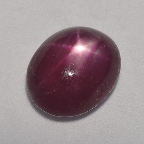 Medium-Dark Purple Rubí Estrella Gema - 5.2ct Cabujón Óvalo (ID: 527879)