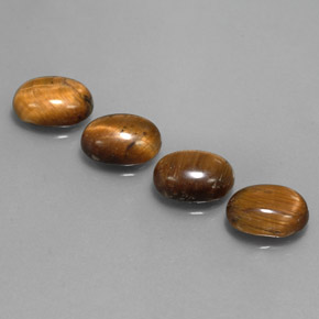 thumb image of 6.4ct Oval Cabochon Gold Brown Tiger's Eye (ID: 342475)