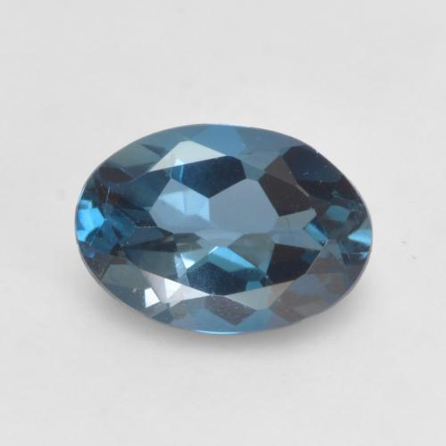 London Blue Topaz Gem - 0.9ct Oval Facet (ID: 535749)