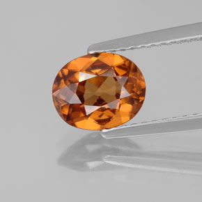 Reddish Orange Zircon Gem - 1.7ct Oval Facet (ID: 358045)