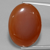 thumb image of 26ct Oval Cabochon Brownish Orange Agate (ID: 432631)
