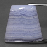 thumb image of 28ct Trapezoid Cabochon Lavender Agate (ID: 432768)