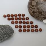 thumb image of 6.3ct Round Cabochon Red Almandine Garnet (ID: 467761)