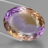 thumb image of 45.6ct Oval Portuguese-Cut Bi-Color Ametrine (ID: 439663)