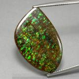 thumb image of 21.3ct Fancy Cabochon Multicolor Ammolite (ID: 377635)