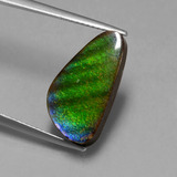 thumb image of 6.5ct Fancy Cabochon Multicolor Ammolite (ID: 447613)