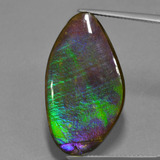 thumb image of 17.3ct Fancy Cabochon Multicolor Ammolite (ID: 451524)