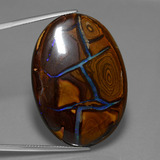 thumb image of 66.3ct Oval Cabochon Multicolor Boulder Opal (ID: 449600)