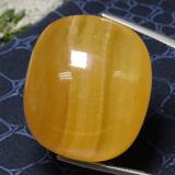 thumb image of 119.6ct Cushion Cabochon Orange Calcite (ID: 469275)