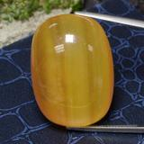 thumb image of 87.7ct Oval Cabochon Orange Calcite (ID: 469313)