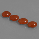 thumb image of 10.4ct Oval Cabochon Orange Red Carnelian (ID: 436798)