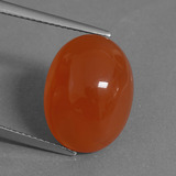 thumb image of 10.3ct Oval Cabochon Orange Red Carnelian (ID: 442783)