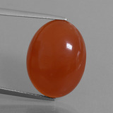 thumb image of 16.3ct Oval Cabochon Orange Red Carnelian (ID: 449544)