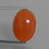 thumb image of 12.1ct Oval Cabochon Orange Red Carnelian (ID: 449548)