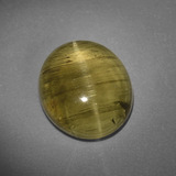 thumb image of 6.4ct Oval Cabochon Golden Green Cat's Eye Apatite (ID: 406299)
