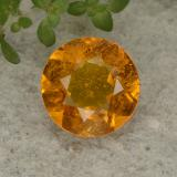 thumb image of 1.6ct Round Facet Yellow Orange Clinohumite (ID: 494986)