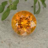 thumb image of 1.1ct Round Facet Yellow Orange Clinohumite (ID: 494990)