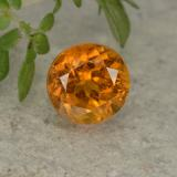 thumb image of 1.2ct Round Facet Yellow Orange Clinohumite (ID: 494992)