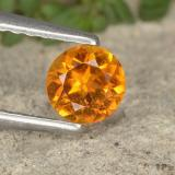 thumb image of 0.4ct Round Facet Yellow Orange Clinohumite (ID: 495090)