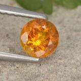 thumb image of 0.5ct Round Facet Yellow Orange Clinohumite (ID: 495106)