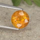 thumb image of 0.5ct Round Facet Yellow Orange Clinohumite (ID: 495180)