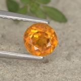 thumb image of 0.6ct Round Facet Yellow Orange Clinohumite (ID: 495201)