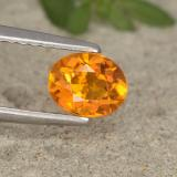 thumb image of 0.6ct Oval Facet Yellow Orange Clinohumite (ID: 495207)