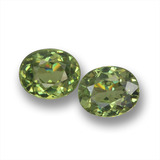 thumb image of 0.9ct Oval Facet Golden Green Demantoid Garnet (ID: 458550)