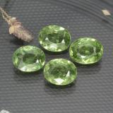 thumb image of 0.4ct Oval Facet Green Demantoid Garnet (ID: 471695)