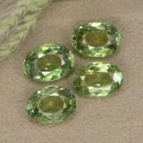 thumb image of 0.6ct Oval Facet Golden Green Demantoid Garnet (ID: 478599)