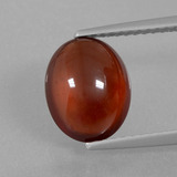 thumb image of 3.2ct Oval Cabochon Orange Hessonite Garnet (ID: 428094)