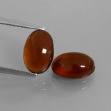 thumb image of 5.3ct Oval Cabochon Orange Hessonite Garnet (ID: 428182)