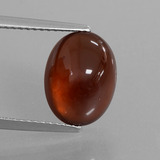 thumb image of 5.6ct Oval Cabochon Orange Hessonite Garnet (ID: 428466)