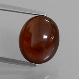 thumb image of 6.2ct Oval Cabochon Orange Hessonite Garnet (ID: 428468)