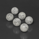 thumb image of 91.6ct Drilled Sphere Greyish White Howlite (ID: 422987)