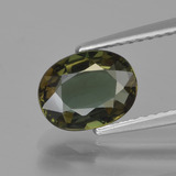 thumb image of 1.5ct Oval Facet Brownish Green Kornerupine (ID: 453465)