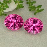 thumb image of 5.3ct Oval Concave Cut Dark Pink Mystic Topaz (ID: 483066)