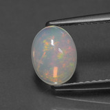 thumb image of 0.8ct Oval Cabochon Multicolor Opal (ID: 429494)