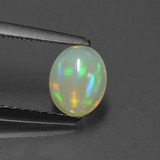 thumb image of 0.6ct Oval Cabochon Multicolor Opal (ID: 431228)