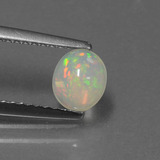 thumb image of 0.5ct Oval Cabochon Multicolor Opal (ID: 432235)