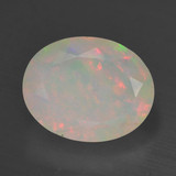 thumb image of 1.3ct Oval Facet Multicolor Opal (ID: 461736)