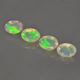 thumb image of 1.6ct Oval Facet Multicolor Opal (ID: 462787)