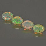 thumb image of 1.9ct Oval Facet Multicolor Opal (ID: 462792)