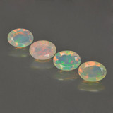 thumb image of 0.4ct Oval Facet Multicolor Opal (ID: 462796)