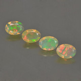 thumb image of 1.6ct Oval Facet Multicolor Opal (ID: 462797)