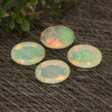thumb image of 0.9ct Oval Facet Yellow Opal (ID: 471760)