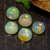 thumb image of 0.7ct Round Cabochon Multicolor Opal (ID: 477507)