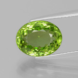 thumb image of 3.7ct Oval Facet Lively Green Peridot (ID: 399275)