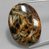 thumb image of 30ct Oval Cabochon Multicolor Pietersite (ID: 346053)