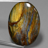 thumb image of 20.6ct Oval Cabochon Multicolor Pietersite (ID: 447778)